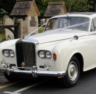 A White Roll Royce